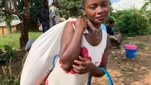 Gislaine, 18, from Kanzuli zuli village near Beni, DRC. He brother had Ebola so she is receiving food so she will stay at home.