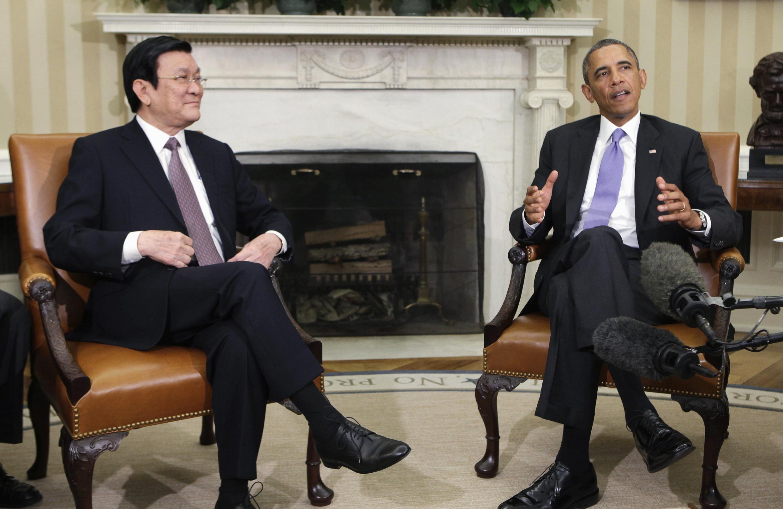 Tổng thống Mỹ Barack Obama (P) tiếp Chủ tịch nước Trương Tấn Sang tại Nhà Trắng hôm 25/07/ 2013.)