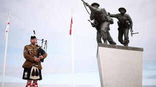 The piper Jerome Levannier plays before the official opening ceremony of the British Normandy Memorial at Ver-sur-Mer, on the 77th anniversary of D-Day, France, June 6, 2021.