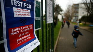 A placard for free Covid-19 PCR tests is posted at a primary school in the Paris suburb of Bagneux, 8 January 2021.