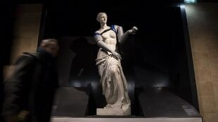 A replica of the Venus de Milo with attached prosthetic arms during an action led by Handicap International at the Louvre-Rivoli metro station in Paris on 6 March, 2018.