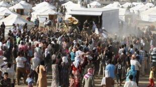 Des réfugiés syriens dans un camp près de la ville d'Erbil, au Kurdistan irakien, en 2013.