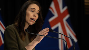 Prime Minister Jacinda Ardern moved most of New Zealand to the lowest virus alert setting on Monday