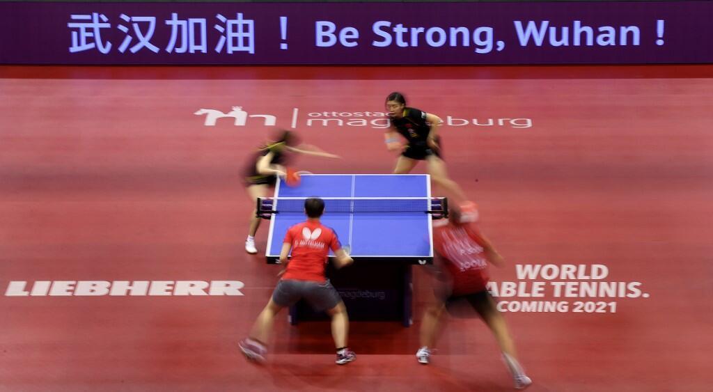 武汉加油 ! «Be strong, Wuhan» (Soyez courageux, Wuhan) pouvait-on lire lors d'une compétition de tennis de table en Allemagne en soutien aux Chinois, le 31 janvier 2020.