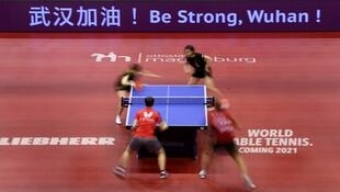 武汉加油 !«Be strong, Wuhan» (Soyez courageux, Wuhan) pouvait-on lire lors d'une compétition de tennis de table en Allemagne en soutien aux Chinois, le 31 janvier 2020.