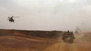 A French military helicopter escorts the vehicle of Malian Prime Minister Moussa Mara on a visit to Kidal this weekend