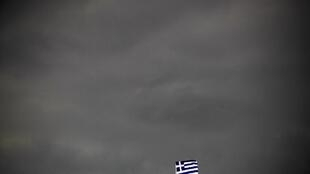 The Greek flag flies in Athens