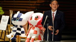 2021-06-03T001038Z_352989618_RC2OSN9FYRRU_RTRMADP_3_OLYMPICS-2020-JAPAN-POLITICS