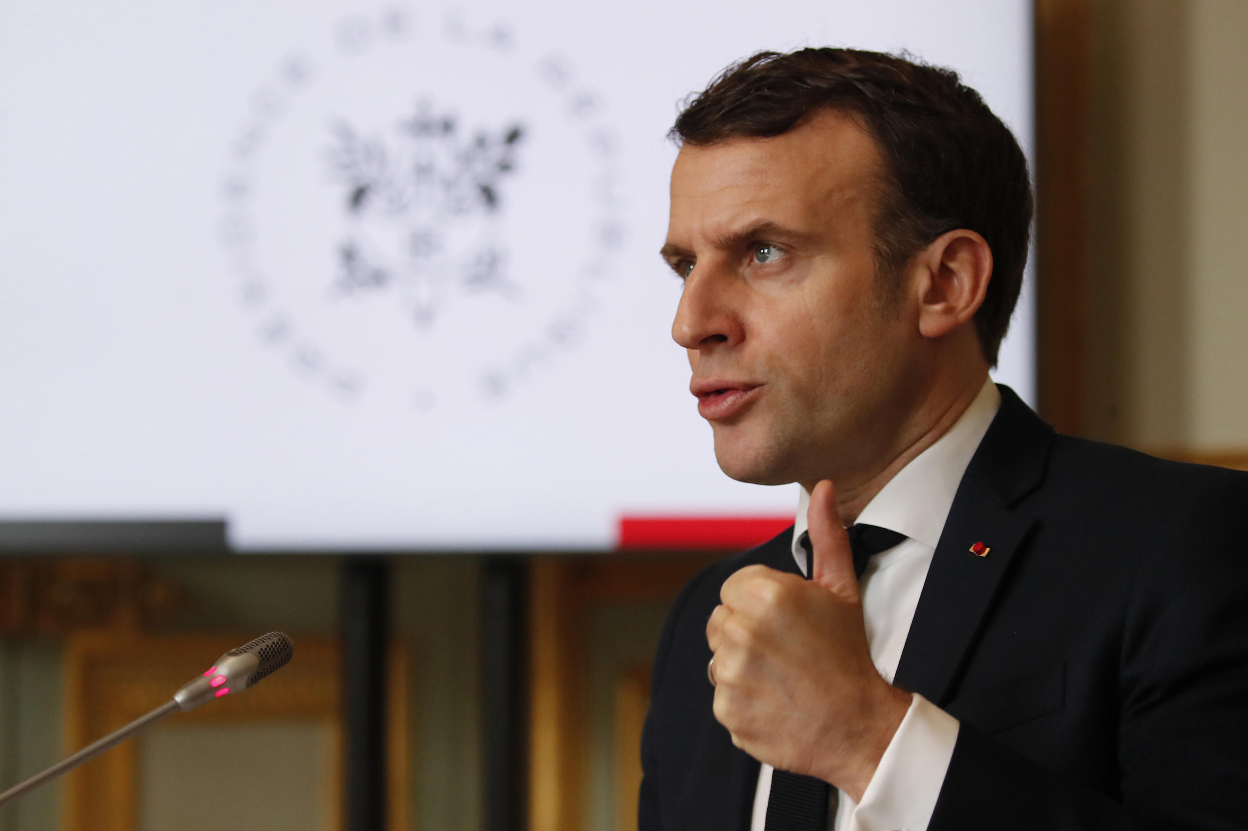 Macron, pictured speaking to the G5 Sahel summit via video link, is under pressure at home to reduce France's anti-jihadist mission