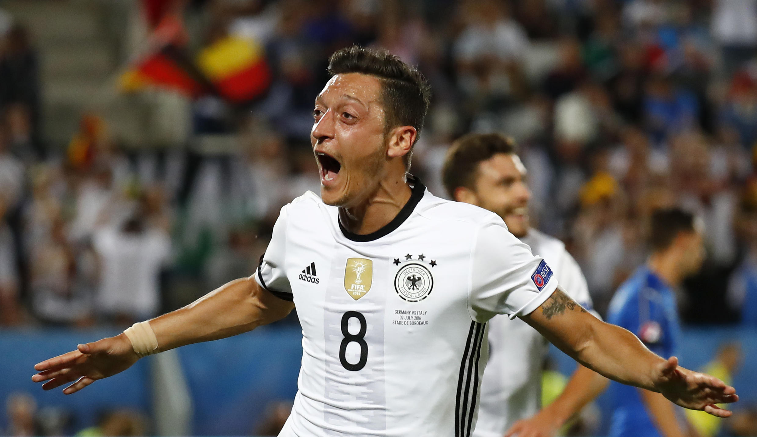 Mesut Ozil opened the scoring for Germany in the quarter-final against Italy in Bordeaux.