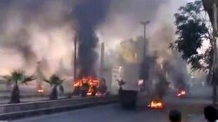 smoke billowing from burning tyres and trash containers in the Al-Hajar al-Aswad district of the Syrian capital Damascus