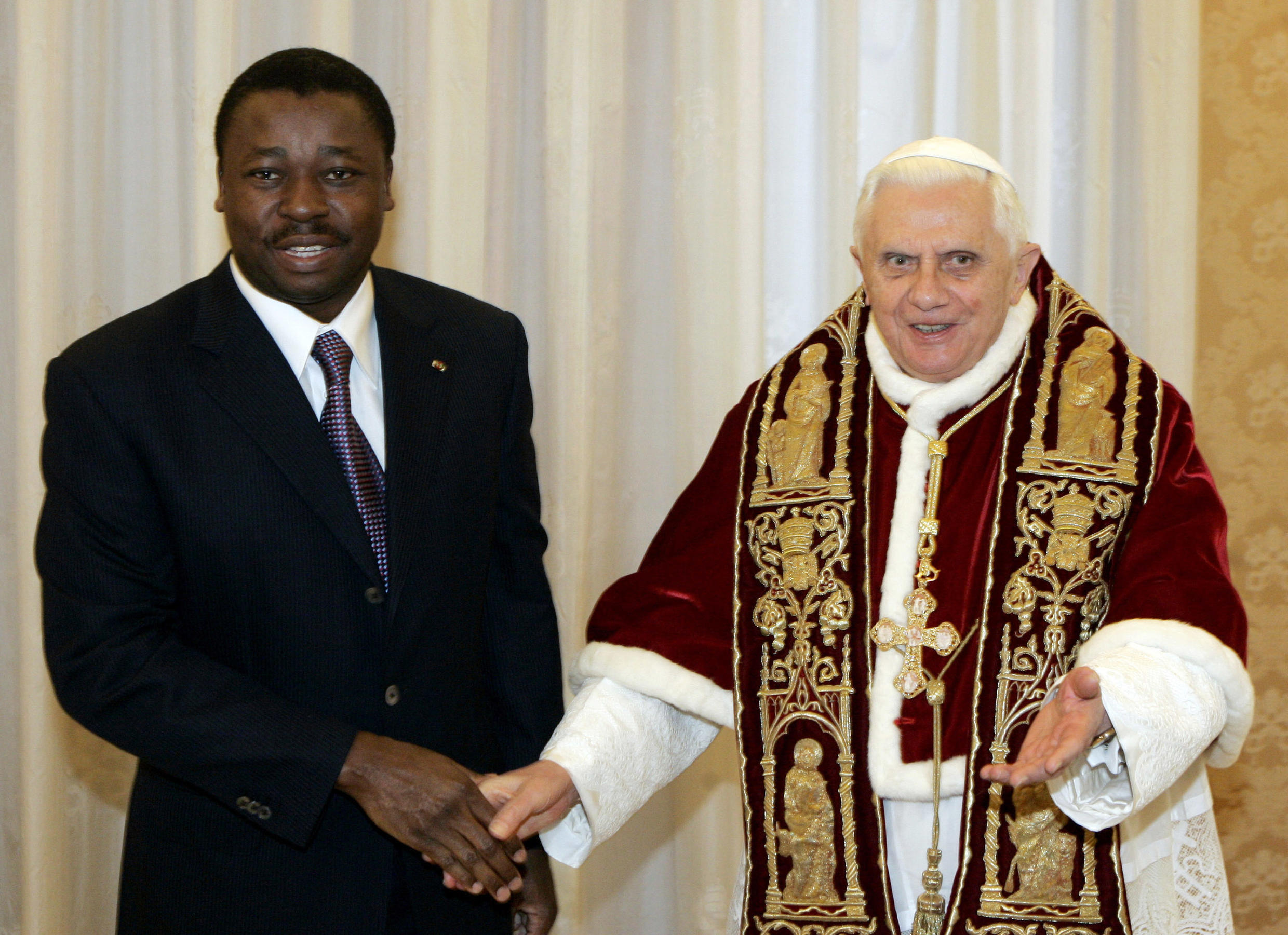 Togo's President Faure Gnassingbé shakes hand with Pope Benedict XVI during a private audience at the Vatican, 19 January 2008.