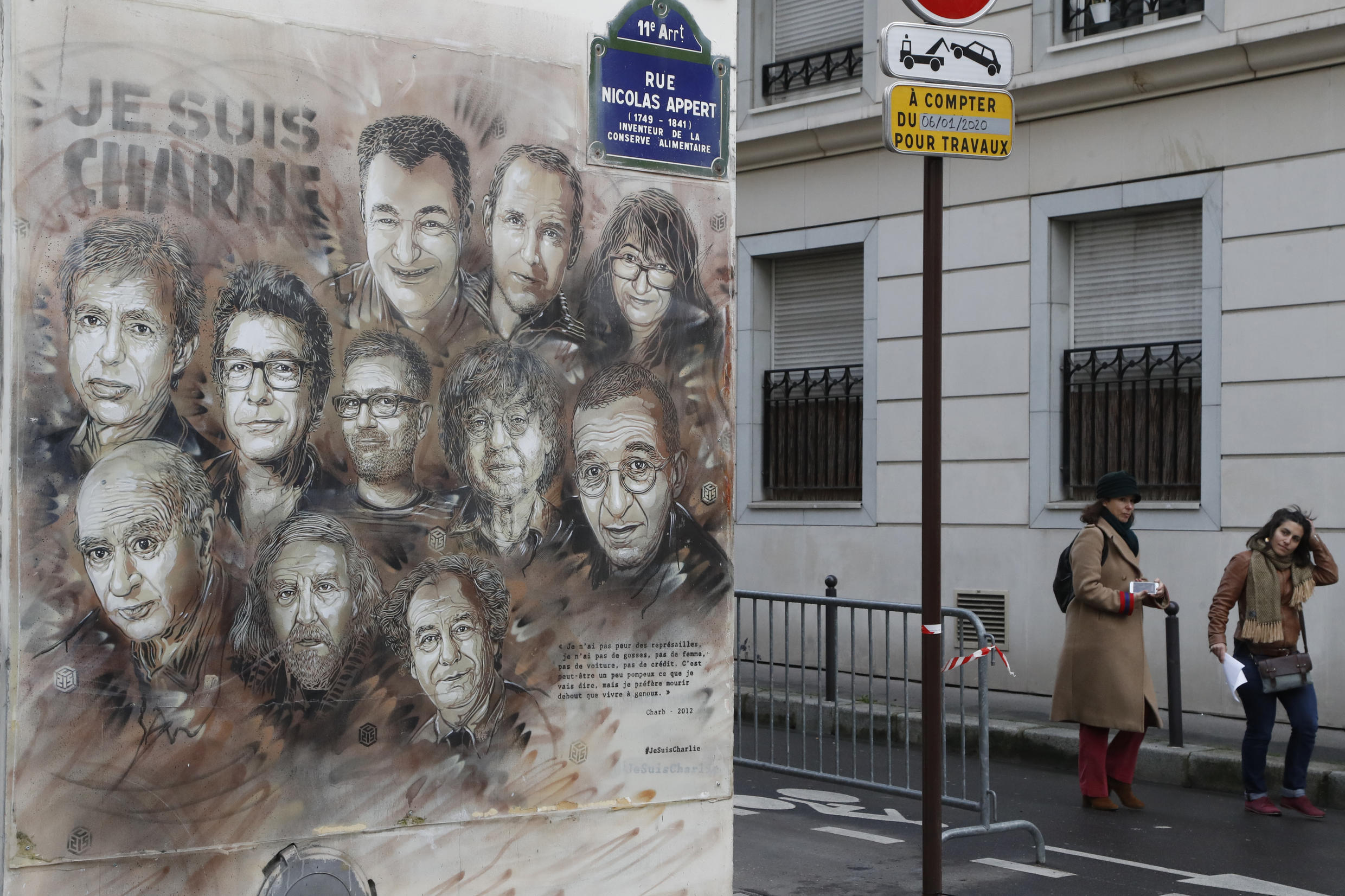 A mural depicting victims of the deadly attack on the Charlie Hebdo newspaper near its offices in Paris.