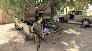 Membres des troupes du Gouvernement d'union nationale libyen, à Tripoli, le 4 juin.