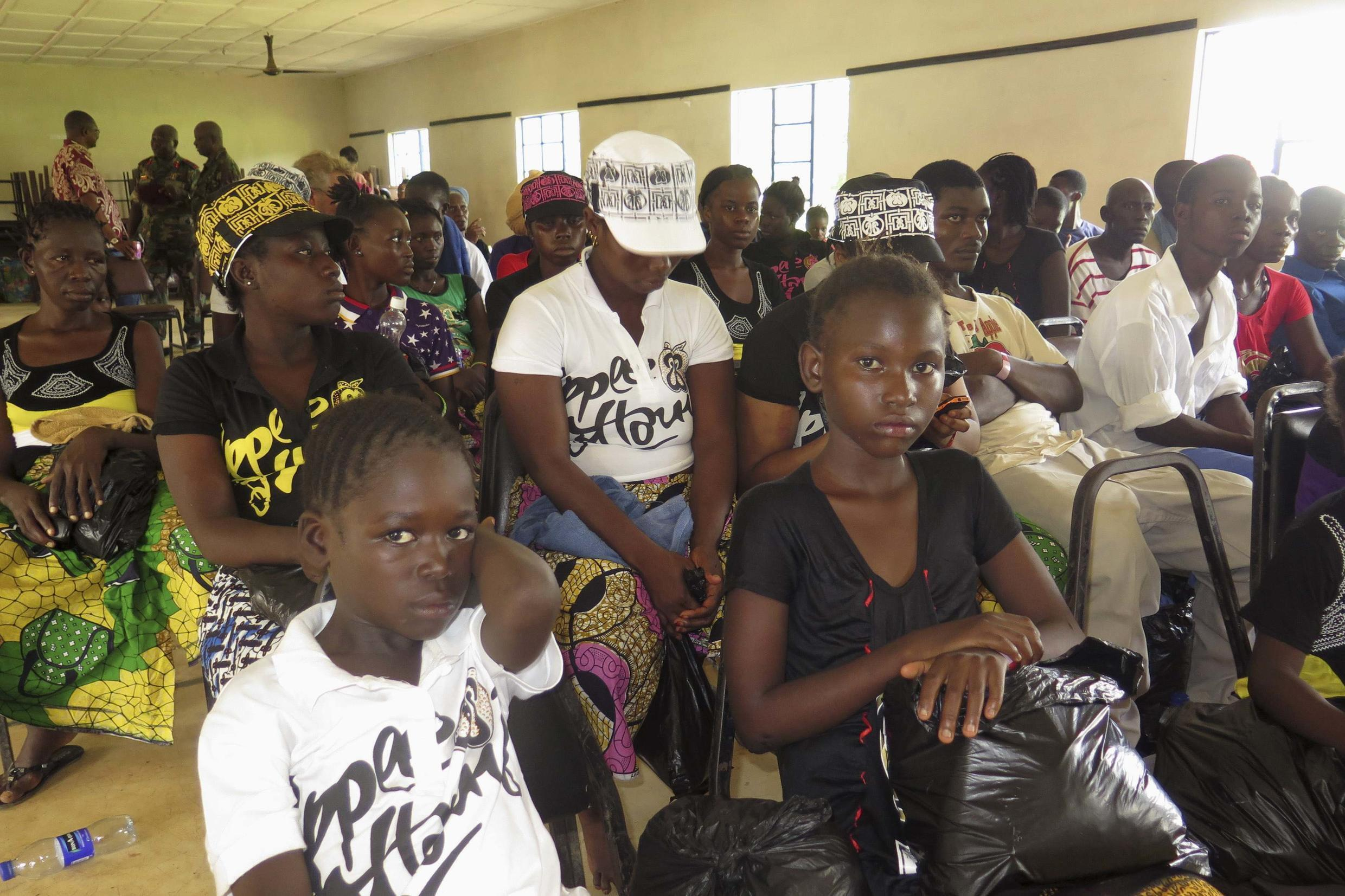 Survivors of the Ebola outbreak attend a discharging ceremony at a health clinic in Freetown, 6 October 2014.
