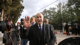 Algeria's presidential candidate Abdelmadjid Tebboune greets attendees during the presidential election in Algiers, Algeria December 12, 2019.