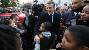 French President Emmanuel Macron meets with Clichy-sous-Bois residents on November 13, 2017.