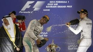 Lewis Hamilton and Nico Rosberg celebrate after the Bahrain Grand Prix