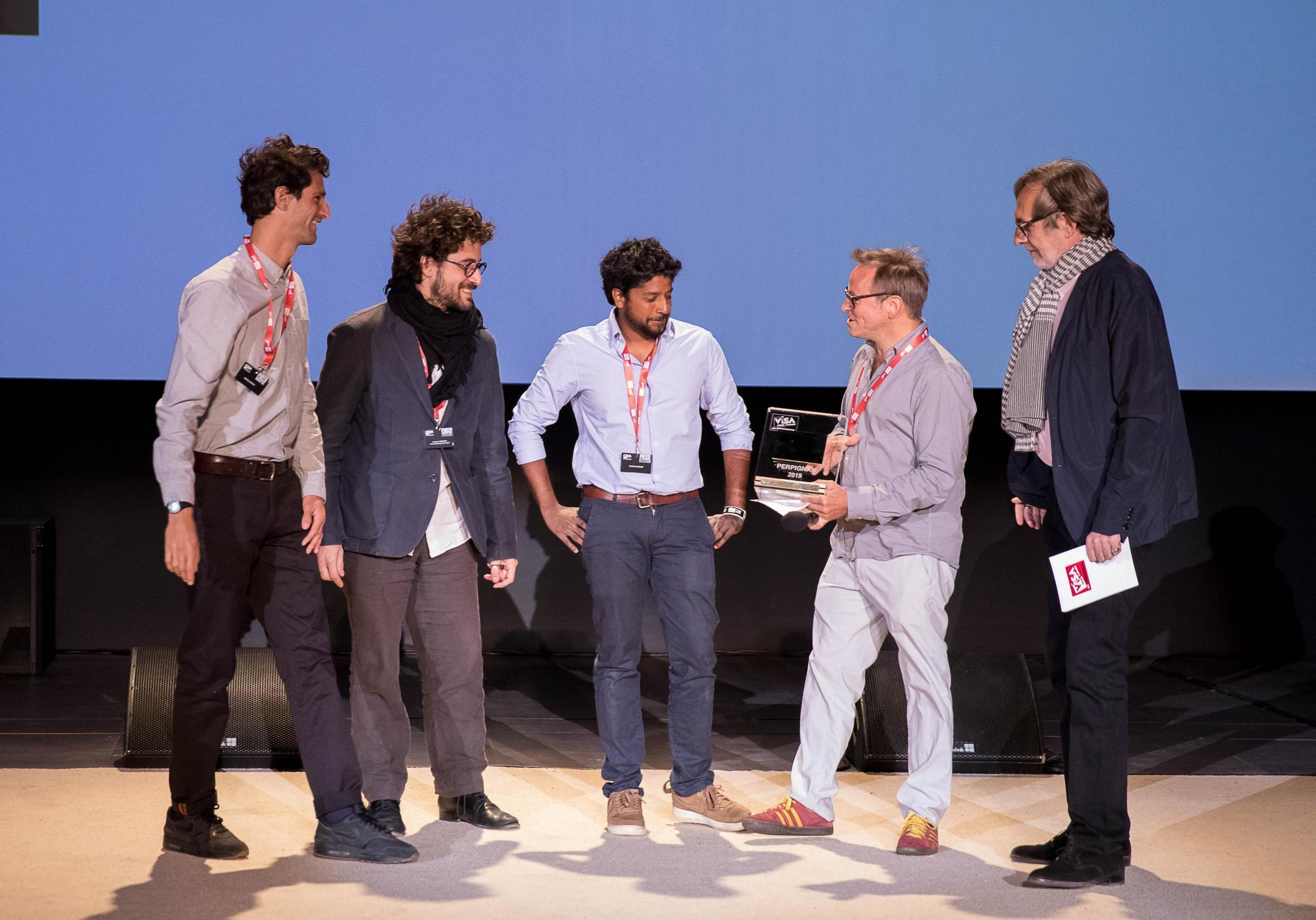 (left to right) Mathias Desta and Geoffrey Livolsi, co-founders of Disclose and photojournalist Lorenzo Tugnoli accepting their award, September 5, 2019