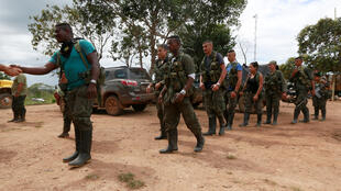 Farc rebels arrive at a camp to prepare for an upcoming congress ratifying a peace deal with the government, near El Diamante, Colombia