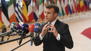 French President Emmanuel Macron speaks to the press at an summit at EU Commission Headquarters in Brussels, 28 May 2019