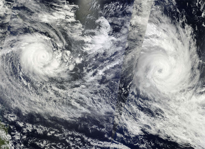 Tropical cyclones Ului and Tomas as seen in the south-western Pacific Ocean on 14 March