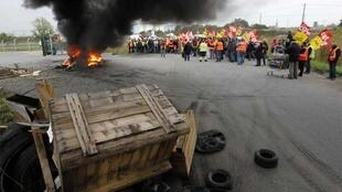 Oil and railworkers picket a refinery near Nantes on Saturday