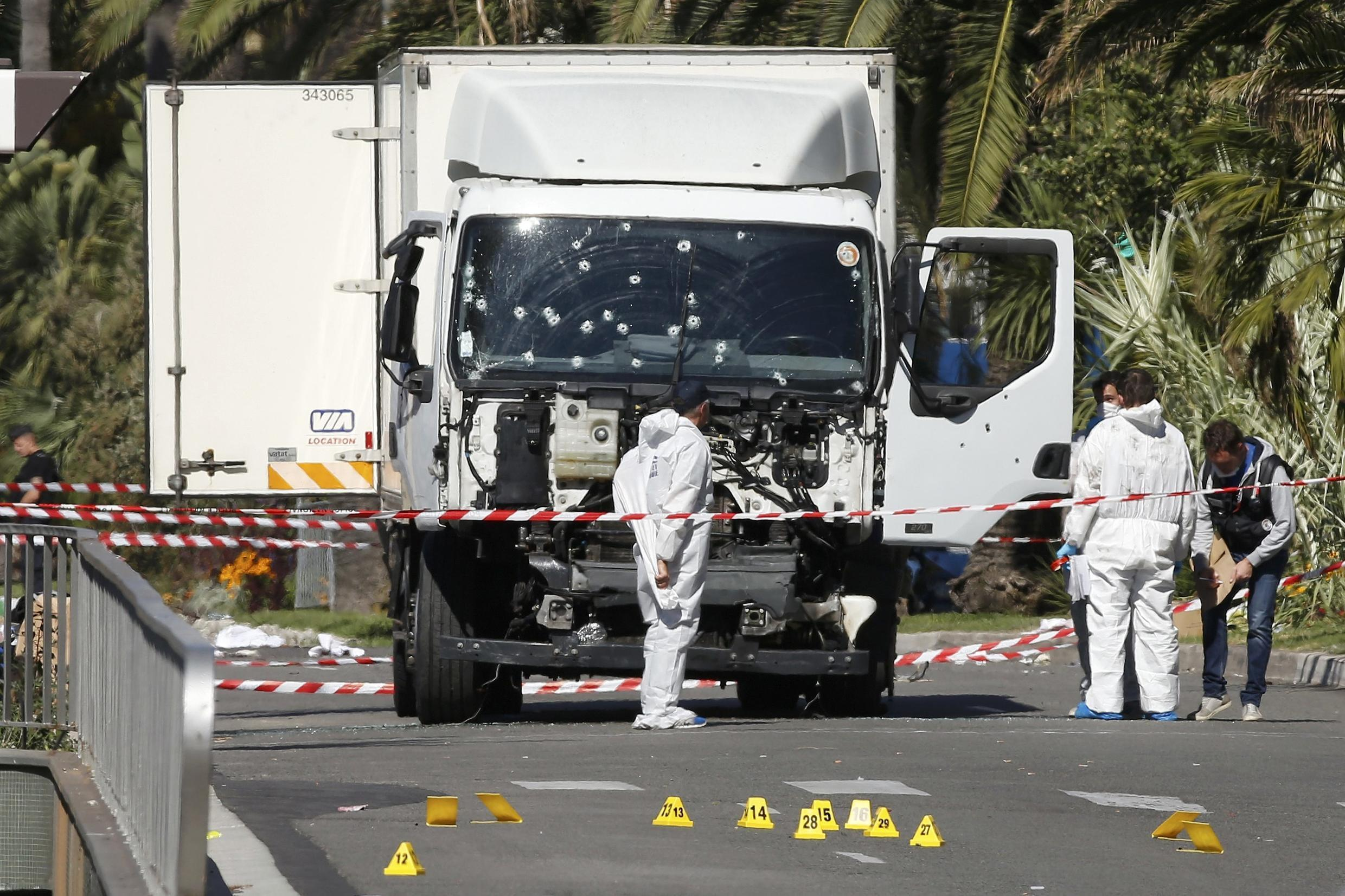 Investigators continue to work at the scene near the truck that ran into a crowd in Nice killing at least 84 people.