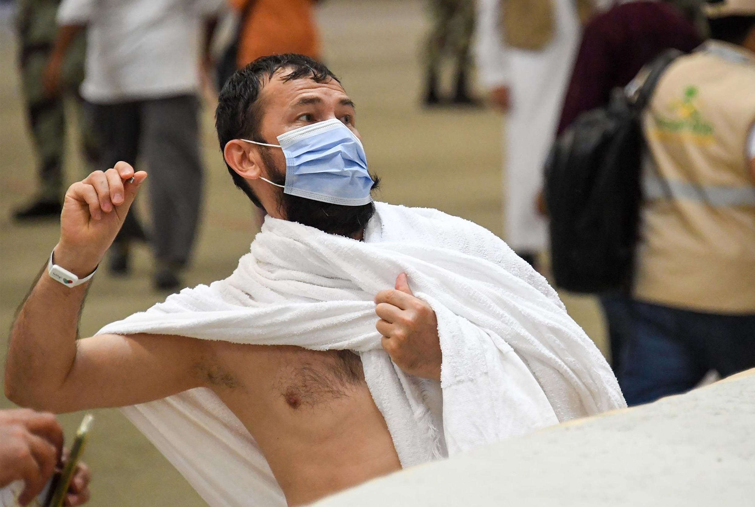 A Muslim worshipper throws pebbles as part of the symbolic al-A'qabah (stoning of the devil ritual) at the Jamarat Bridge during the Hajj pilgrimage