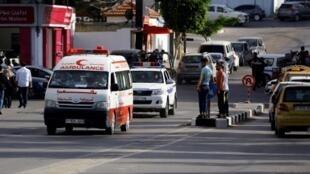 L'ambulance transportant les corps des trois hommes accusés de l'assassinat de Mazen Faqha. Gaza, le 25 mai 2017.