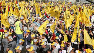 Marche en mémoire de Yasser Arafat, disparu le 11 novembre 2004, à Gaza ce samedi, à laquelle ont pris part des militants du Fatah aux drapeaux jaunes. Le Fatah et le Hamas ont signé le 12 octobre dernier un accord de réconciliation au Caire.