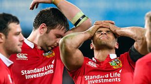 British and Irish Lions players Iain Henderson and team mate Jonathan Joseph react after losing to the Otago Highlanders.