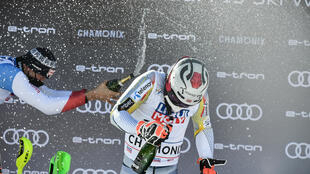 Norway's Henrik Kristoffersen celebrates with champagne after winning the Chamonix slalom