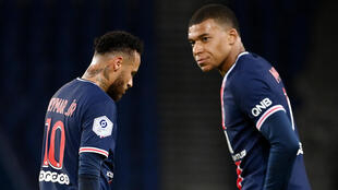 Neymar (left) and Kylian Mbappé both featured in Paris Saint- Germain's starting line-up against RB Leipzig.