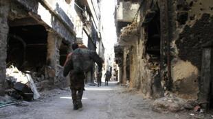 Les combattants du groupe Etat islamique contrôlent toujours plusieurs poches en Syrie : l'une d'elles se trouve à Hajar al-Aswad et Yarmouk (photo) au sud de Damas.
