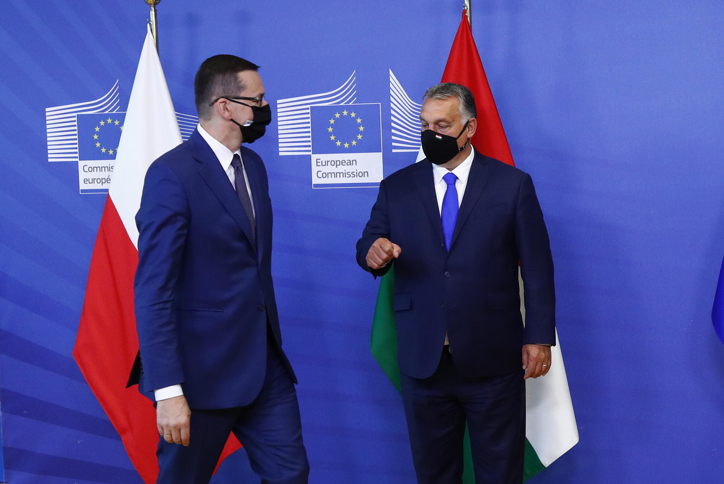 Poland's Prime Minister Mateusz Morawiecki (L) and Hungary's Prime Minister Viktor Orban have accused the EU of mounting a power grab over efforts to increase oversight over the rule of law