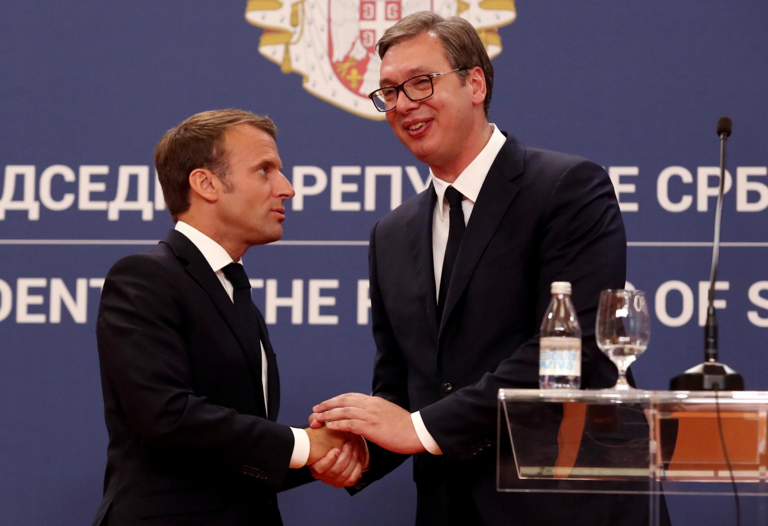 French President Emmanuel Macron and Serbian President Aleksandar Vucic shake hands after a joint news conference, Serbia, July 15, 2019.