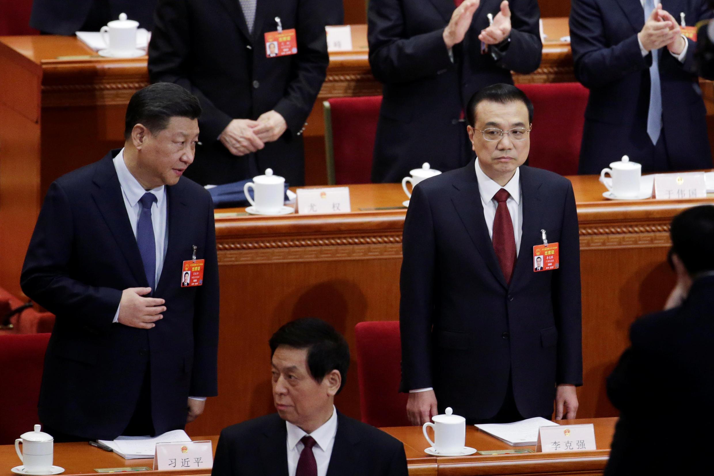 Chủ tịch Trung Quốc Tập Cận Bình (T) và thủ tướng Lý Khắc Cường tại khóa họp Quốc Hội thường niên, Bắc Kinh, ngày 05/03/2019