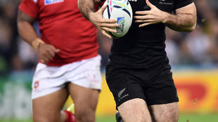 New Zealand's wing Nehe Milner-Skudder (R) runs with the ball during a Pool C match of the 2015 Rugby World Cup between New Zealand and Tonga at St James' Park in Newcastle-upon-Tyne, northeast England, October 9, 2015