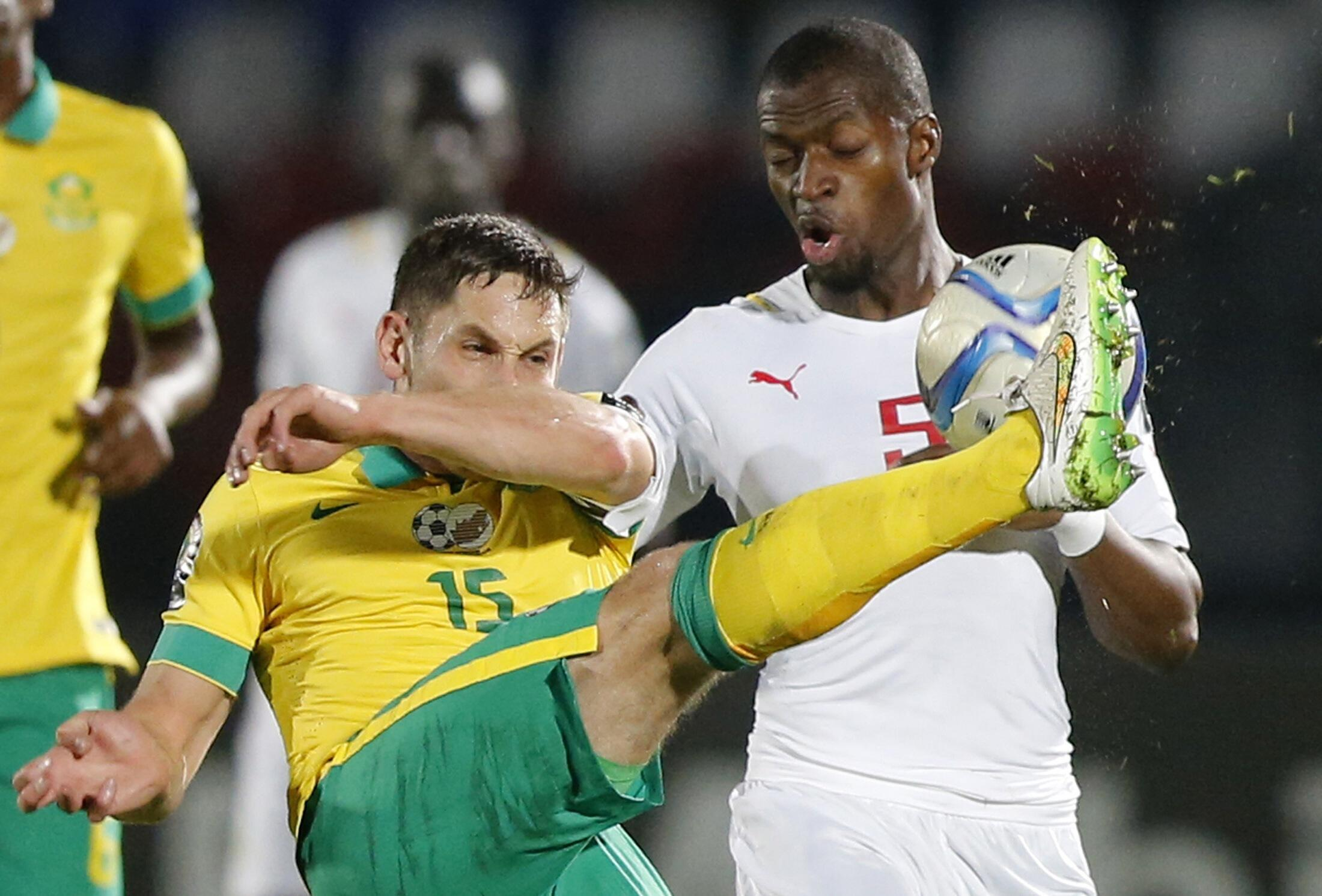 South Africa's Dean Furman (L) challenges Senegal's Pape Kouli Diopi