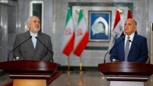 Le ministre des Affaires étrangères iranien Mohammad Javad Zarif avec son homologue irakien Fuad Hussein, le 19 juillet 2020 à Bagdad, lors d'une conférence de presse.