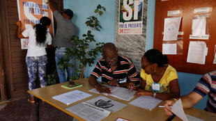 Officials prepare a polling station for the constitutional referendum in Havana, Cuba, February 17, 2019.