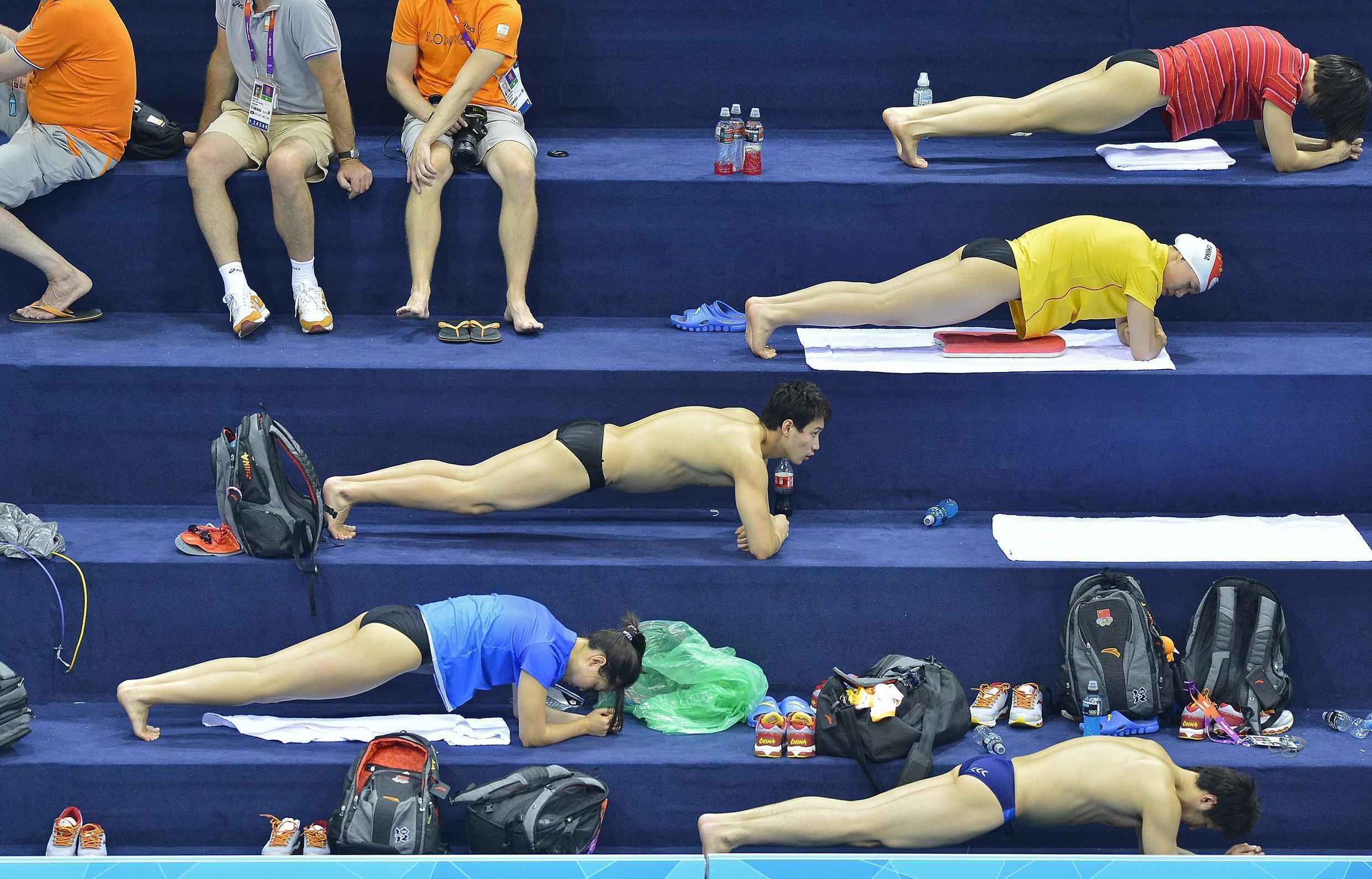 Chinese swimmers perform strength exercises at the Aquatics Centre in the Olympic Park in Stratford