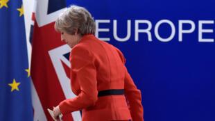 英國首相特里莎.梅10月21日在歐盟總部布魯塞爾