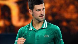 Novak Djokovic celebrates after winning against Germany's Alexander Zverev in the Australian Open quarter-final