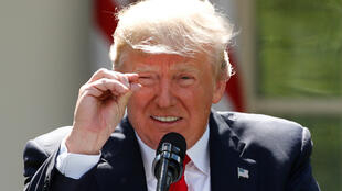 Trump refers to amounts of temperature change as he announces his decision that the United States will withdraw from the landmark Paris Climate Agreement, in the Rose Garden of the White House in Washington, U.S., June 1, 2017.