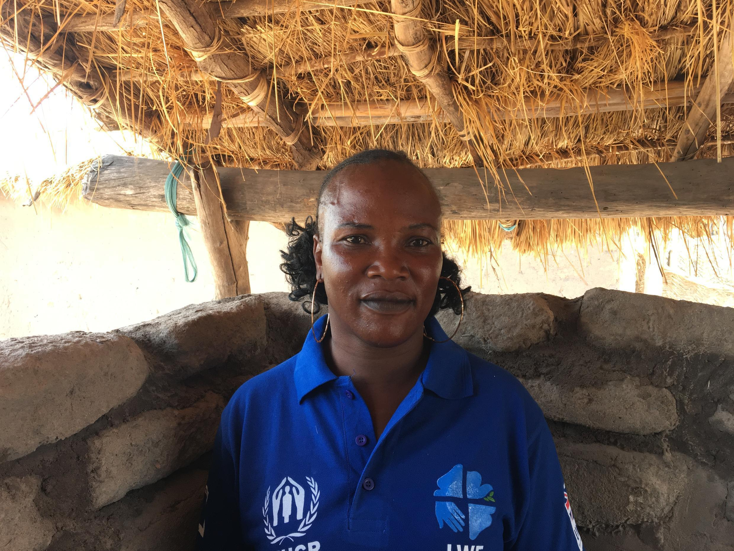 Justine Baydou, 31, CAR refugee and the women's representative in Damboko camp; takes care of her daughter, niece and 5 orphans