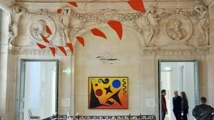 Big Red, 1959, a signature mobile by Alexander Calder and Seven Black, Red and Blue, 1947, at home in the Picasso Museum in Paris