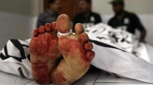 The body of a man who was killed by unidentified gunmen at a morgue in Karachi's Abbasi hospital