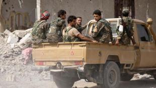 Combattants des Forces démocratiques syriennes dans la région de Raqqa.